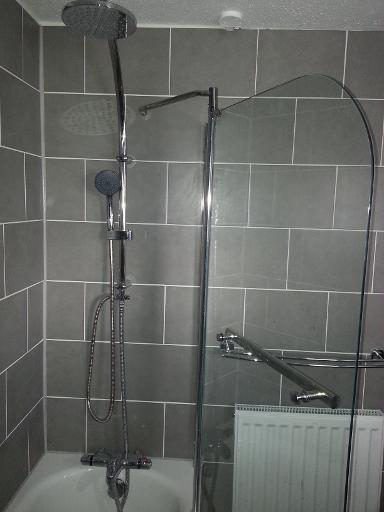 a new rain dance shower and screen with freshly tiled walls